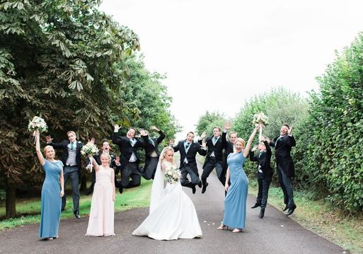 Wedding Party posing. Photo by Helen Cawte Photography